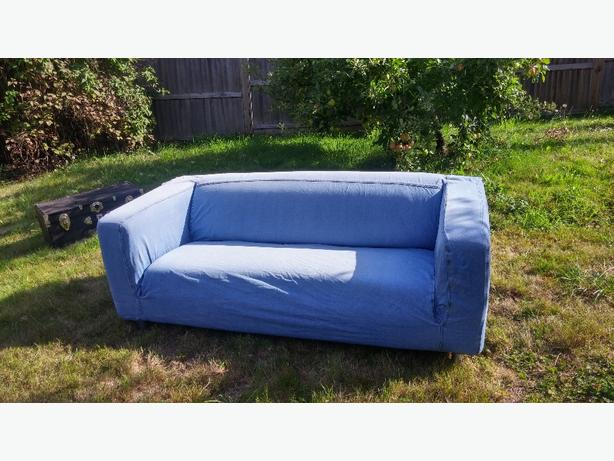 White loveseat with denim cover