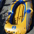 Inflatable rafts and paddles