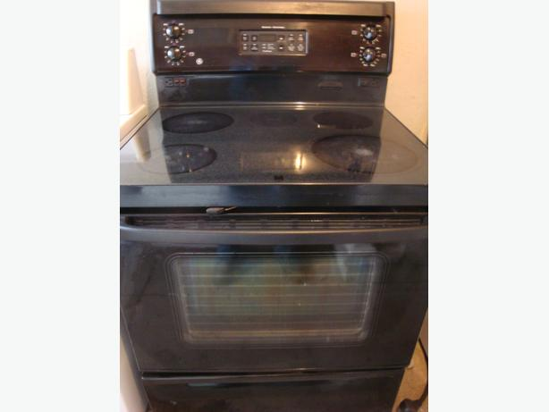 GE flat top black stove,with self clean oven