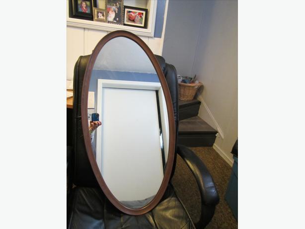 Oval teak framed mirror