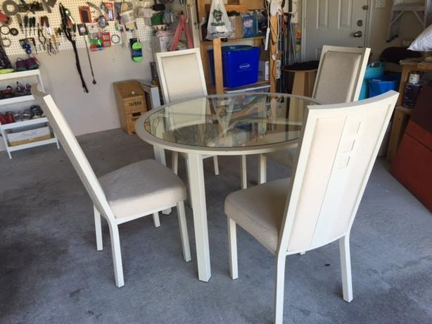 Round metal and glass dining table with 4 chairs