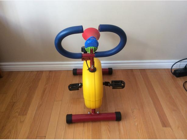 A child's stationary exercise bike