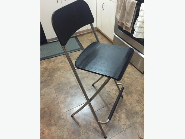 pair of black ikea franklin bar stools esquimalt view