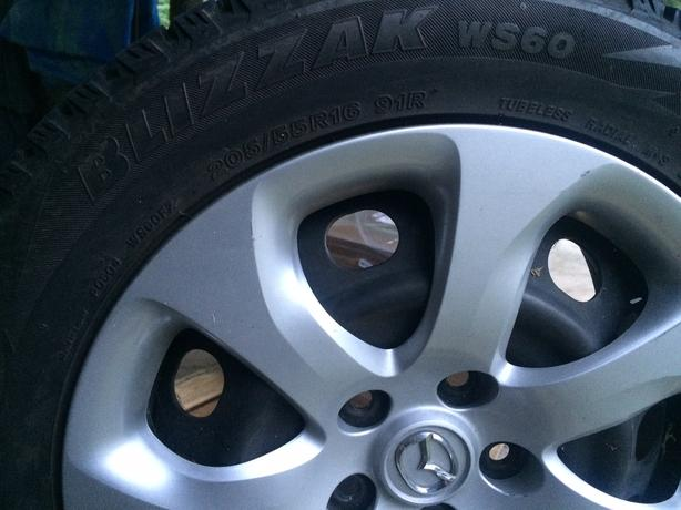 Bridgestone Blizzack winter tires on rims