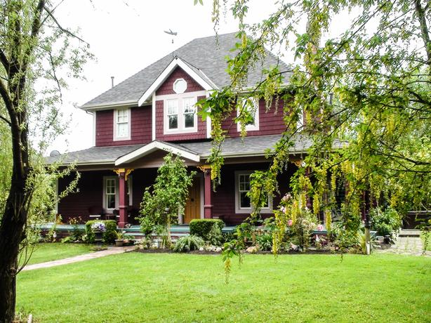 Beautiful Victorian-Style Home With Detached Garage on 2 Private Acres