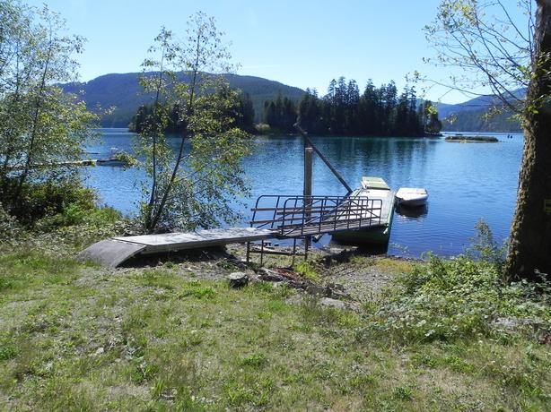 Private Lakefront RV Lot for summer weekly rental with your own dock.