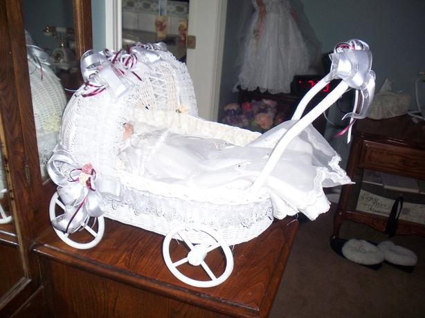 Porcelain Doll in Wicker Cradle