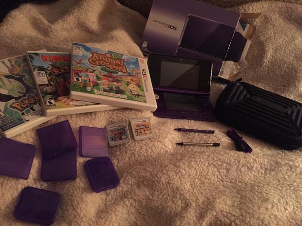 purple Nintendo 3DS plus accessories