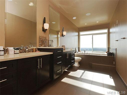 Floor to ceiling east facing windows fill the living west for Floor to ceiling windows for sale