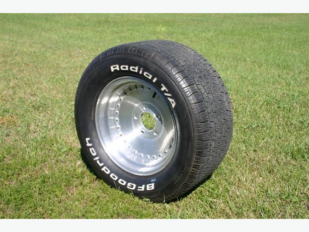 One Centerline 15x8.5 wheel with 295/50 tire