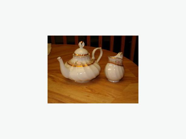 tea pot  china , from   Portugal, and creamer  bowl, firm $30.00