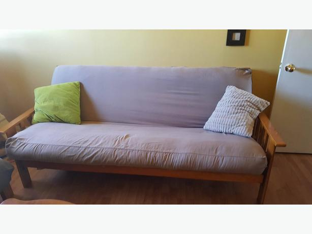 Wooden framed futon and mattress with cover