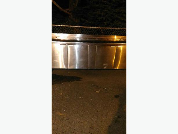 Prep cooler table and stainless steel sink in great condition.