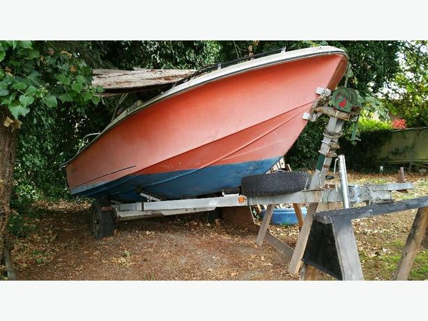 boat trailer and 19 foot hull