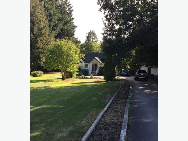 JUST REDUCED!! Cute Home on Beautiful Acreage