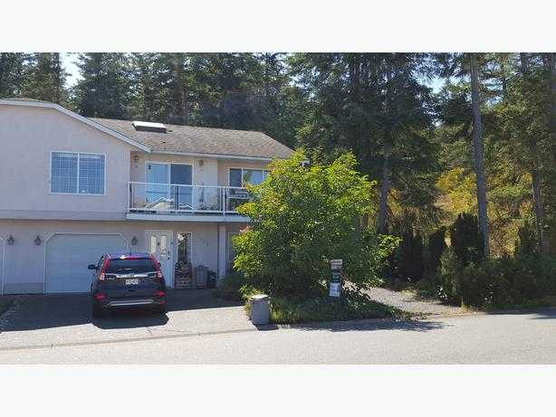Just Reduced! Affordable Ocean View Home & No Strata Fees