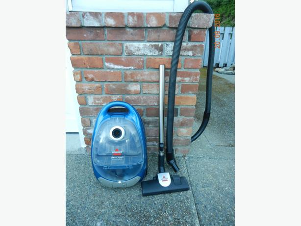 Bissell Vacuum with attachments and accessories