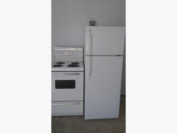apartment size fridge stove and dishwasher in working condition and