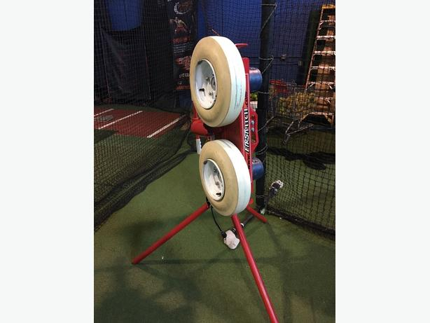 First Pitch Curveball pitching machine and automatic Ball feeder