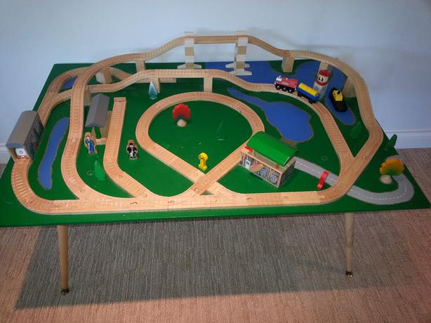 Wooden train railway on table