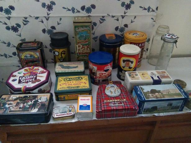 Assorted advertising tins