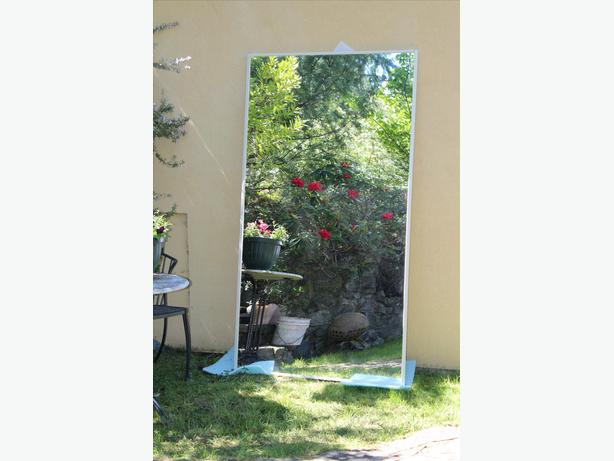 Mirror sliding door with tracks