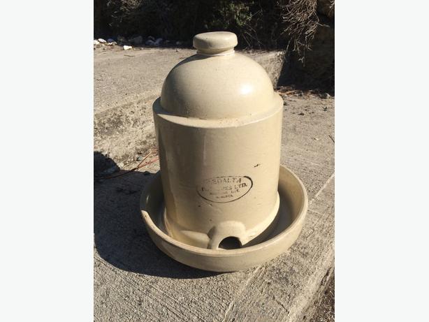 Medalta stoneware chicken feeder with base