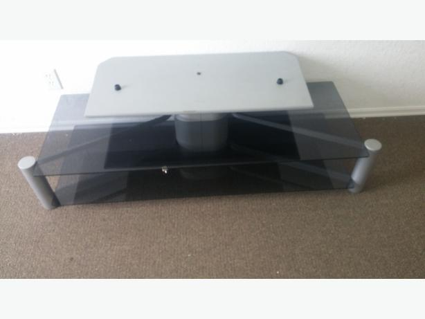 LARGE GREY AND SMOKED GLASS COFFEE TABLE/T.V STAND ( LIKE NEW CONDITION