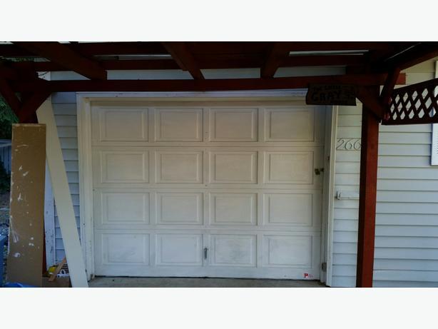 7 x 9 solid wood garage door.