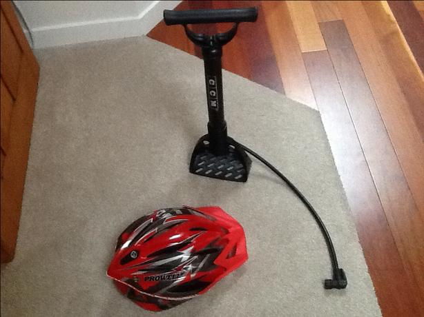 CYCLING HELMET AND BICYCLE PUMP