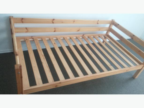 SOLID PINE DAY BED FRAME WILL FIT A SINGLE MATTRESS OR A MEDEIM SIZE FUTON