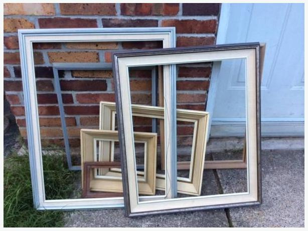 six assorted painting frames
