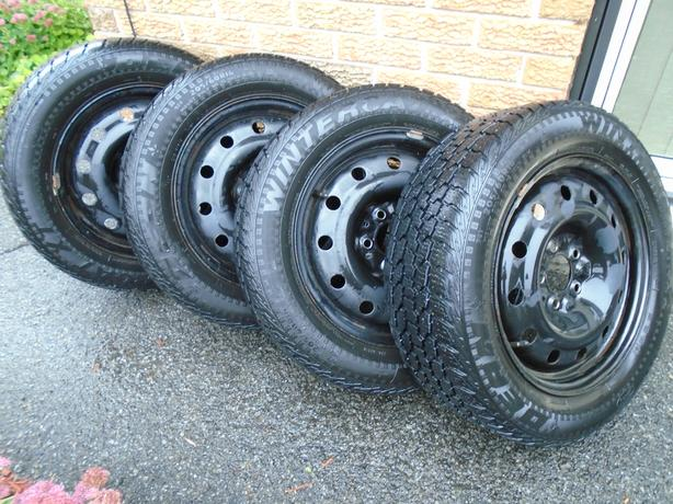 16 Inch winter tires on steel rims for sale.