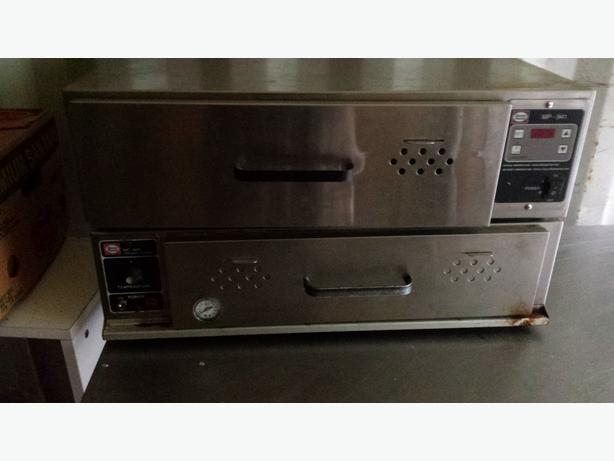 commercial stainless steel table and $ 200 for two food warmers