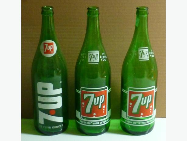 For sale vintage 7 up pop bottles
