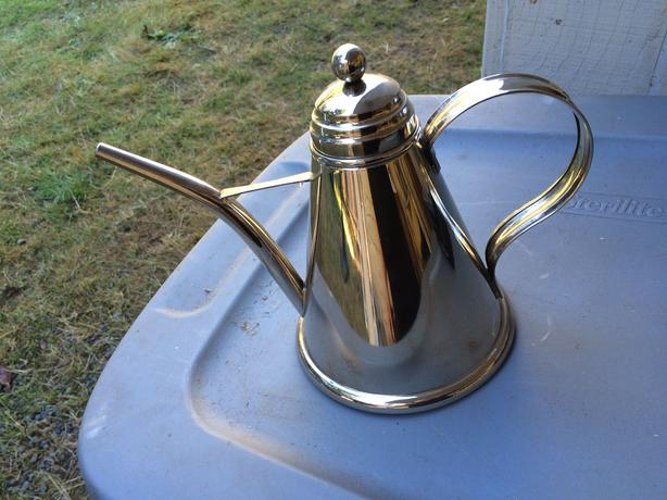 Vintage stainless steel teapot with narrow spout
