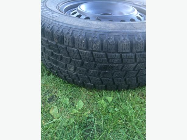 4 bridgestone blizzak tires on rims 235/65/16R