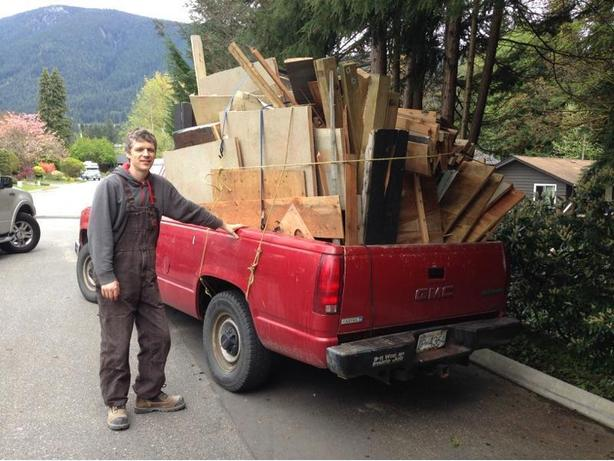 Man with pickup truck and trailer for junk removal.