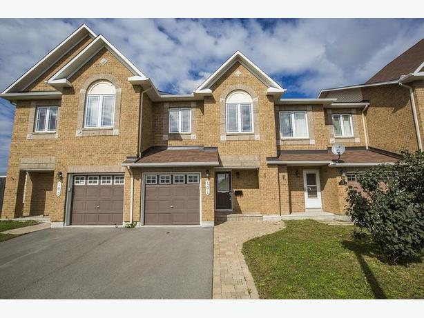 Beautiful freehold open concept 3 bedroom 2 bath home with ensuite