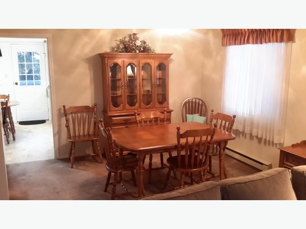 Maple table with six chairs and buffet/hutch.