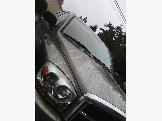Dodge Ram 1500 SLT 4WD, 5.7L HEMI, QUAD CAB, under 100K on odo.