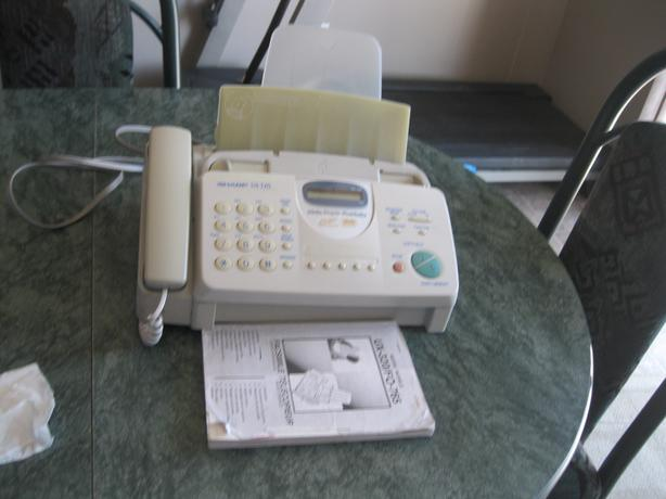 Sharp fax machine with photocopier