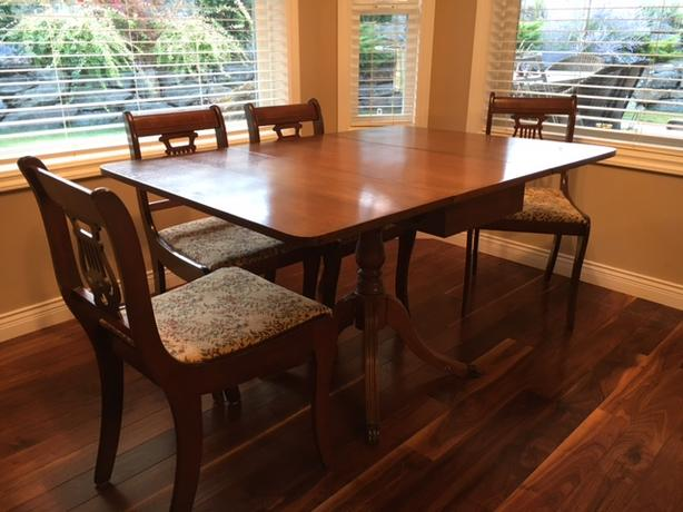 older drop-leaf table with 4 upholstered chairs