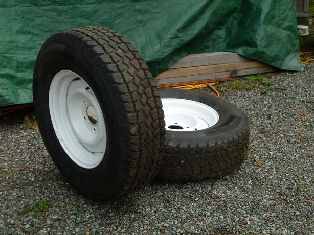 Pair of 235/75R15 winter tires on rims