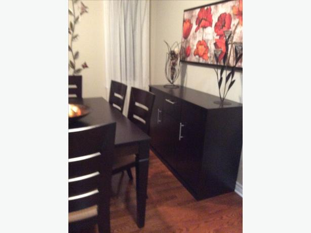 Dinning room table with 8 chairs and hutch