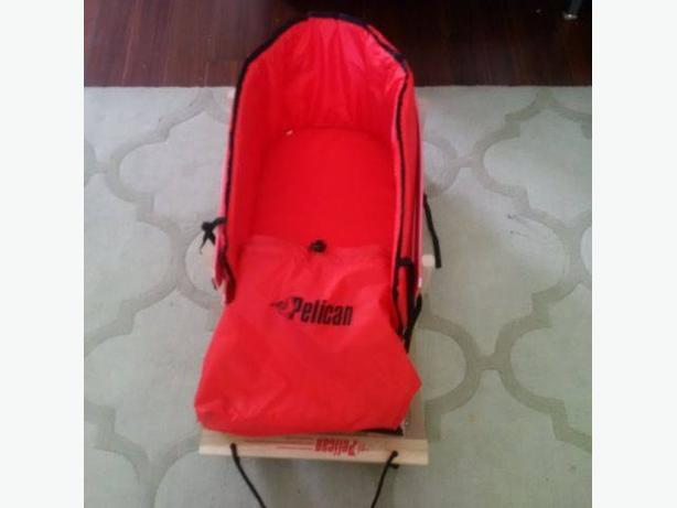 Pelican wooden sleigh with foam back rest and plastic shelter