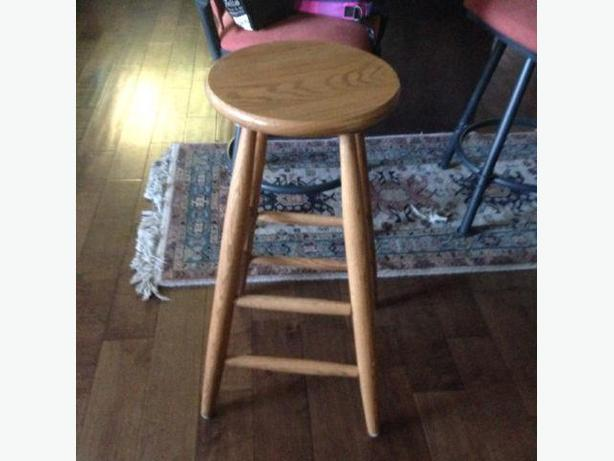 2 Oak Swivel bar stools .