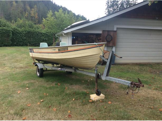 14' Aluminum boat with trailer.