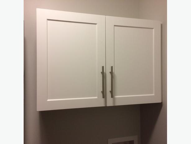 "2 door white cabinet  24""H x 34 3/4""L x 12""D"