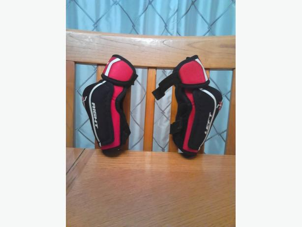 hockey gear - shin guards and elbow pads